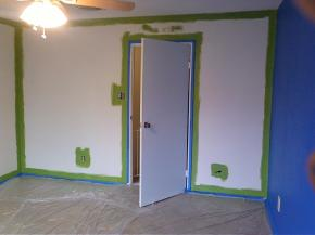 Cutting In.  trans v.  The Process of Painting Around Doors, Sockets, Ceilings, Baseboards and any-other-such-stuff in order to create a clean, professional look.
