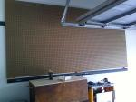"Here's the empty pegboard - I ripped some 1x down into 1"" strips and placed those strips across the studs.  The pegboard is about 3/8ths thick, which gives it plenty of integrity.  Very little twisting, very sturdy.  Minimum of structure."