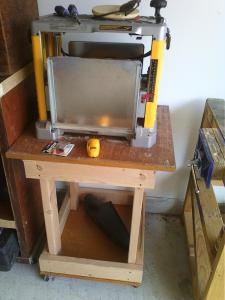 "The power planer stand with some recycled wainscotting as platforms.  2"" castors.  Integrated with the height of the bandsaw/router table."