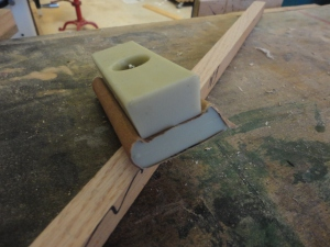 Sanding block with flat, curved and a nice triangular profile for corners and such.