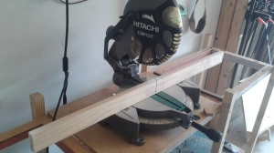 This saw has been outfitted with a wood fence.  I screw it into the metal fence, then run a test cut.  I end up with a perfect kerf which tells me exactly where my cut line will be and a strong surface for clamping.  I can also mark it for individual projects, such as cutting pen blanks.