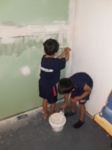 Helpers getting the drywall jointed